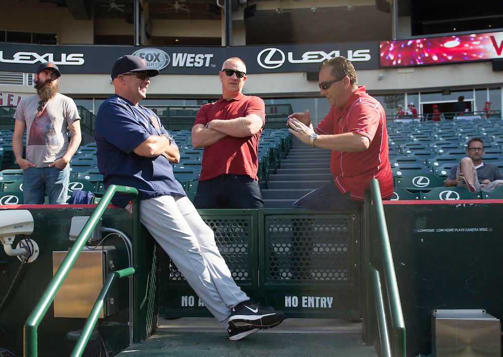 Former Angel Wally Joyner, currently hitting coach for the Detroit Tigers, chats with friends before the Angels game Monday at Angel Stadium.<br /> <br /> ///ADDITIONAL INFO:   <br /> <br /> angels.0531.kjs  ---  Photo by KEVIN SULLIVAN / Orange County Register  -- 5/30/16<br /> <br /> The Los Angeles Angels take on the Detroit Tigers Monday at Angel Stadium.