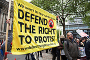 On a day when 400,000 public sector workers go on strike over cuts, pay and pensions, other protesters came out to protest against the police and to defend the right to protest. London, UK.