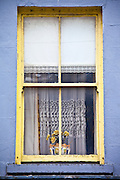 Lace curtains and a lace-trimmed roller blind in typical window in Ennistymon (Ennistimon), County Clare, West of Ireland