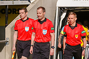 Match Referee Willie Collum and his 2 assistants lead the teams out ahead of the Ladbrokes Scottish Premiership match between St Mirren and Dundee at the Paisley 2021 Stadium, St Mirren, Scotland on 30 March 2019.