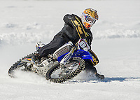 Tim Dinan of Belmont races around the plowed track on Lily Pond Saturday morning.  (Karen Bobotas/for the Laconia Daily Sun)