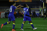 AFC Wimbledon striker Lyle Taylor (33) and AFC Wimbledon striker Dominic Poleon (10) during the The Emirates FA Cup 1st Round Replay match between AFC Wimbledon and Bury at the Cherry Red Records Stadium, Kingston, England on 15 November 2016. Photo by Stuart Butcher.