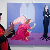 VENICE, ITALY - JUNE 01:  Artist Giuseppe Veneziano stands in front of one of his works at Galleria Contini on June 1, 2011 in Venice, Italy. Veneziano's controversial paintings portray  pop culture icons and historical figures.