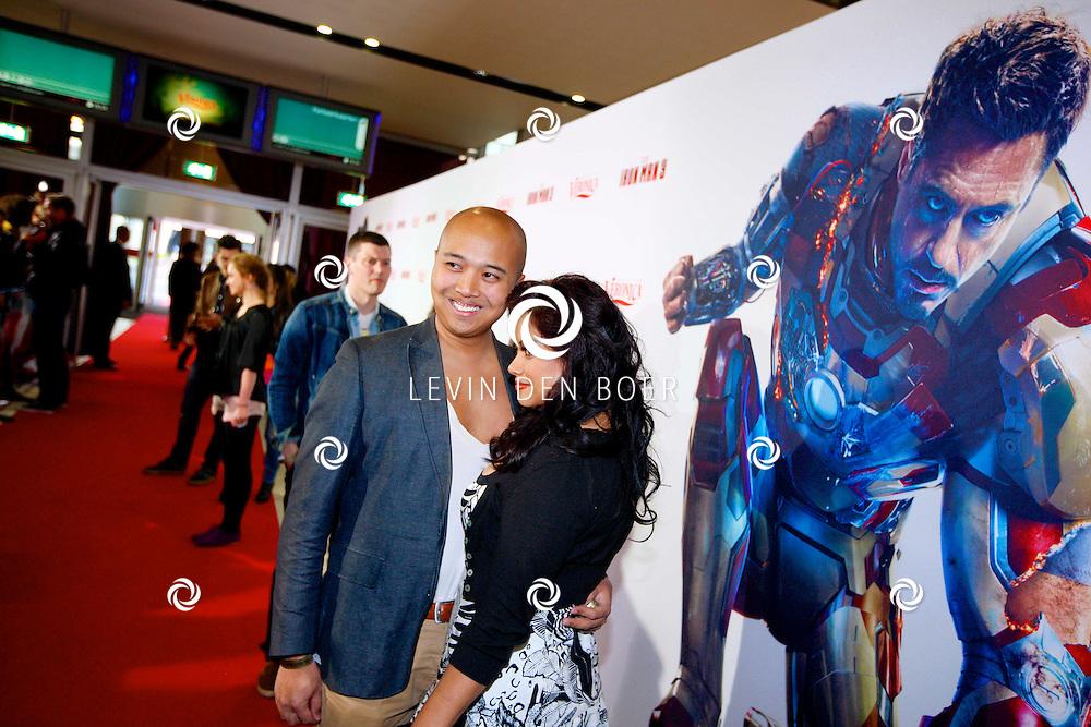 AMSTERDAM - In het Rai theater is de filmpremiere van Iron Man 3. Met op de foto  Linda Wagenmakers met partner Greg Kromosoeto. FOTO LEVIN DEN BOER - PERSFOTO.NU