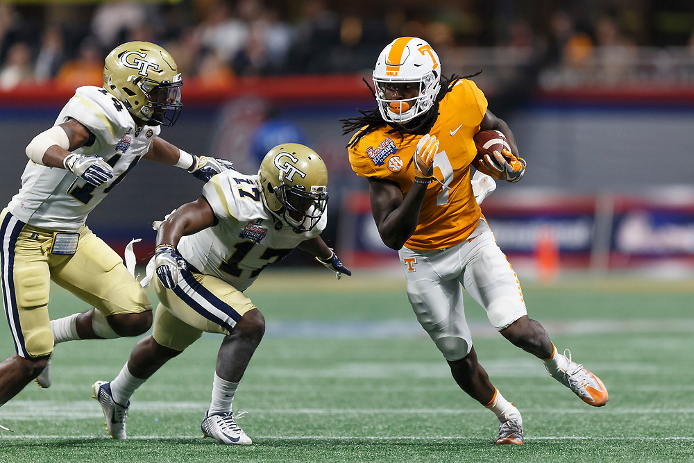 Tennessee Volunteers wide receiver Marquez Callaway (1) carries the ball pas Georgia Tech Yellow Jackets defensive back Lance Austin (17) and defensive back Corey Griffin (14) during the second half of the Chick-fil-A Kickoff NCAA football game on Monday, September 4, 2017, in Atlanta. Tennessee won in two overtimes, 42-41. (Paul Abell via Abell Images for Chick-fil-A Kickoff Game)