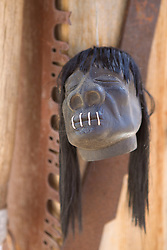 funny shrunken head on a  wall