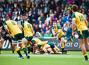Australia's Harry Nucifora throws a pass to Australia full-back Jack Maddocks during the World Rugby U20 Championship 5rd Place play-off  match Australia U20 -V- New Zealand U20 at The AJ Bell Stadium, Salford, Greater Manchester, England on Saturday, June  25  2016.(Steve Flynn/Image of Sport)