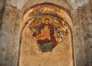 Pictures & images of the medieval  fresco of the Madonna and Child Alaverdi St George Cathedral & monastery complex, 11th century, near Telavi, Georgia (country). <br /> <br /> At 50 meters high Alaverdi St George Cathedral was once the highest cathedral in Georgia (now its the nes Tblisi cathedral). The cathedral is part of a Georgian Orthodox monastery founded by the monk Joseph [Abba] Alaverdeli, who came from Antioch and settled in Alaverdi. On the UNESCO World Heritage Site Tentative List. .<br /> <br /> Visit our MEDIEVAL PHOTO COLLECTIONS for more   photos  to download or buy as prints https://funkystock.photoshelter.com/gallery-collection/Medieval-Middle-Ages-Historic-Places-Arcaeological-Sites-Pictures-Images-of/C0000B5ZA54_WD0s .<br /> <br /> Visit our REPUBLIC of GEORGIA HISTORIC PLACES PHOTO COLLECTIONS for more photos to browse, download or buy as wall art prints https://funkystock.photoshelter.com/gallery-collection/Pictures-Images-of-Georgia-Country-Historic-Landmark-Places-Museum-Antiquities/C0000c1oD9eVkh9c
