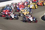 Ryan Briscoe, #2, leads the pack through turn 1 during the GoPro Indy Grand Prix of Sonoma at Infineon Raceway in Sonoma, Calif., on Aug. 26, 2012.  Briscoe would go on to win the Grand Prix with a total time of 2:07:02:8248 and an average speed of 95.74 MPH.  Photo by Stan Olszewski/SOSKIphoto.