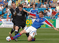 Carlisle's Danny Livesey and Swansea's Daryl Duffy