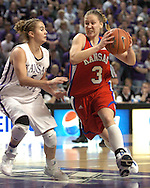 Kansas guard Ivana Catic (R) drives into the lane against pressure from Kansas State guard Shalee Lehning (L) during the first half of K-State's 69-63 win over the Jayhawks at Bramlage Coliseum in Manhattan, Kansas, January 25, 2006.