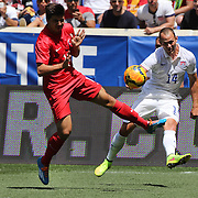 Brad Davis, (right), USA, crosses the ball past Ozan Tufan, Turkey, during the US Men's National Team Vs Turkey friendly match at Red Bull Arena.  The game was part of the USA teams three-game send-off series in preparation for the 2014 FIFA World Cup in Brazil. Red Bull Arena, Harrison, New Jersey. USA. 1st June 2014. Photo Tim Clayton