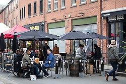 © Licensed to London News Pictures. 16/10/2020. Manchester, UK. People enjoy an outdoor seating area in Northern Quarter, Manchester. Manchester is on the verge of a Tier 3 lockdown. Photo credit: Kerry Elsworth/LNP