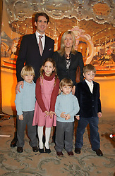 CROWN PRINCE PAVLOS and PRINCESS MARIE CHANTAL OF GREECE with their children, left to right, PRINCE CONSTANTINE, PRINCESS OLYMPIA and PRINCE ACHILEAS and MASTER CONRAD GETTY son of Princess Chantal's sister Pia Getty at a children's party in aid of the charity Over The Wall held at Fortnum & Mason, Piccadilly, London before a gala premiere of the new musical Mary Poppins at The Prince of Wales Theatre, Old Compton Street, London W1<br />
