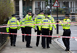 © Licensed to London News Pictures. 02/04/2019. London, UK. Police are seen at the cordon in Kentish Town, north London, where a man in his 20s was found with fatal stab wounds at 8.30 pm on 1st April.  Another man has been stabbed in Edmonton this morning. Photo credit: Peter Macdiarmid/LNP