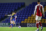 AFC Wimbledon midfielder Callum Reilly (33) battles for possession during the EFL Trophy match between AFC Wimbledon and U21 Arsenal at Plough Lane, London, United Kingdom on 8 December 2020.