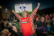 An England fan wearing a 2-1 score prediction on his t-shirt celebrating the win after the Euro 2020 semi final match between England and Denmark on the 7th of July 2021 at the outdoor screen at Folkestone Harbour Arm, in Folkestone, United Kingdom.