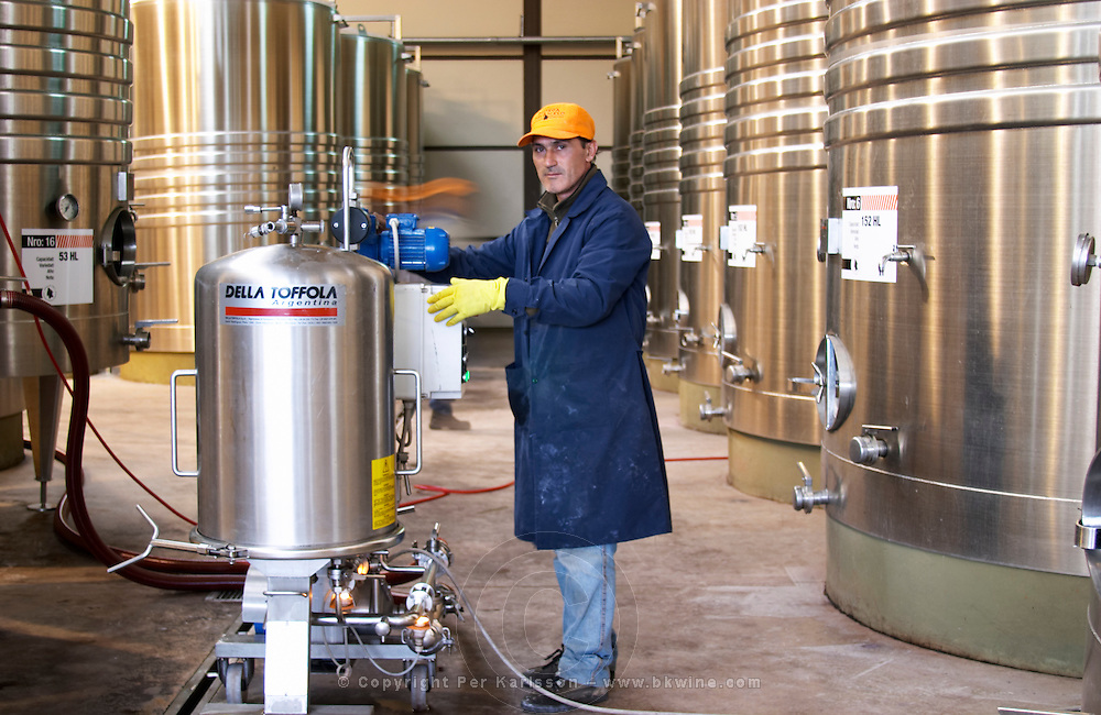 stainless steel tanks. winery worker, filter Bodega Del Anelo Winery, also called Finca Roja, Anelo Region, Neuquen, Patagonia, Argentina, South America