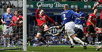 Photo: Paul Thomas.<br /> Everton v Manchester United. The Barclays Premiership. 28/04/2007.<br /> <br /> John O'Shea of Utd scores their first for the after noon from a mistake by Everton keeper Iain Turner (Grey).