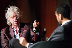 © Licensed to London News Pictures. 24/07/2014. Musician and Campaigner Sir Bob Geldof speaks with Waleed Aly (right) during a session of the 20th International AIDS conference held in Melbourne Australia. Photo credit : Asanka Brendon Ratnayake/LNP
