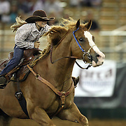 Mckenna Hickson of Okeechobee, Florida races barrels during the 129th performance of the PRCA Silver Spurs Rodeo at the Silver Spurs Arena   on Friday, June 1, 2012 in Kissimmee, Florida. (AP Photo/Alex Menendez) Silver Spurs rodeo action in Kissimee, Florida. PRCA rodeo event in Florida. The 129th annual running of the cowboy event.