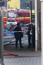 © Licensed to London News Pictures. 16/01/2013. London, UK. Wreckage is seen  near Vauxhall in London today (16/01/13) after a helicopter crashed into a crane attached to a high rise building. Photo credit: Matt Cetti-Roberts/LNP