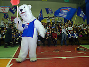 """Wahlkampf Veranstaltung der Putin Partei """"Einiges Russland"""" vor den Duma Wahlen im Sport Palast der sibirischen Stadt Jakutsk. Jakutsk hat 236.000 Einwohner (2005) und ist Hauptstadt der Teilrepublik Sacha (auch Jakutien genannt) im Foederationskreis Russisch-Fernost und liegt am Fluss Lena. Jakutsk ist im Winter eine der kaeltesten Grossstaedte weltweit mit durchschnittlichen Winter Temperaturen von -40.9 Grad Celsius.<br /> <br /> Election campaign meeting of the Putin party """"United Russia"""" in the Yakutsk sport palace a few days before the Duma elections in Russia. Yakutsk is a city in the Russian Far East, located about 4 degrees (450 km) below the Arctic Circle. It is the capital of the Sakha (Yakutia) Republic (formerly the Yakut Autonomous Soviet Socialist Republic), Russia and a major port on the Lena River. Yakutsk is one of the coldest cities on earth, with winter temperatures averaging -40.9 degrees Celsius."""