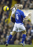 1/1/2005 - FA Barclays Premiership - Tottenham Hotspur v Everton - White Hart Lane<br />Tottenham Hotspur's Pedro Mendes mistimes his high tackle and manages to put a boot in the face of Everton's Thomas Gravesen.<br />Photo:Jed Leicester/Back Page Images