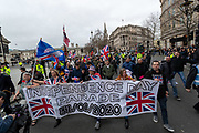 January 31, 2020, London, England, United Kingdom: Dozens of Brexit supporters march through Trafalgar Square to celebrate Britain's departure from the EU in London, Friday, Jan. 31, 2020. Britain officially leaves the European Union on Friday after a debilitating political period that has bitterly divided the nation since the 2016 Brexit referendum. (Credit Image: © Vedat Xhymshiti/ZUMA Wire)