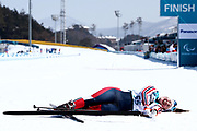 Vilde Nilsen of Norway collapses after crossing the finish line during the Women's 6 km Standing Biathlon competition at Alpensia Biathlon Centre on Day 1 of the PyeongChang 2018 Paralympic Games on March 10, 2018 in Pyeongchang-gun, South Korea.