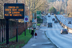 © Licensed to London News Pictures. 20/12/2020. London, UK. Road to nowhere. A Covid-19 warning sign is displayed on the A3 Roehampton Vale, South West London as health Secretary Matt Hancock warns Londoners not to leave the Capital. Yesterday Prime Minister, Boris Johnson put London and the South East into Tier 4 lockdown restrictions after a Covid-19 mutation spread rapidly thought the Capital. In his address to the Nation last night, he outlined that Christmas is effectively cancelled with the closing of non-essential shops and a ban on travel, mixing with different households and Christmas bubbles after a dramatic rise in infections. Last Wednesday London was put into Tier 3 after the new Covid-19 variant was discovered. Photo credit: Alex Lentati/LNP