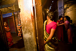 Sex workers wait for customers at a brothel in Tangail, Bangladesh.