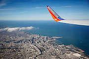 """SHOT 9/3/13 12:52:22 PM - The skyline of downtown Chicago, Ill. and Lake Michigan as seen from a Southwest Airlines flight leaving from Midway Airport. Chicago is the largest city in the US state of Illinois and the third most populous city in the United States, with around 2.7 million residents. Its metropolitan area, sometimes called """"Chicagoland,"""" is the third largest in the United States, with an estimated 9.8 million people within its metropolitan area. Chicago is the county seat of Cook County. Chicago has many nicknames, which reflect the impressions and opinions about historical and contemporary Chicago. The best known include: """"Chi-town,"""" """"Windy City,"""" """"Second City,"""" and the """"City of Big Shoulders. (Photo by Marc Piscotty / © 2013)"""