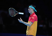 Tennis - 2018 Nitto ATP Finals at The O2 - Day Two<br /> <br /> Mens singles : Kevin Anderson (RSA) v Kei Nishikori (JPN)<br /> <br /> A dejected Kei Nishikori of Japan on his way to a 6-0 6-1 defeat, throws his racket in the air<br /> <br /> COLORSPORT/ANDREW COWIE