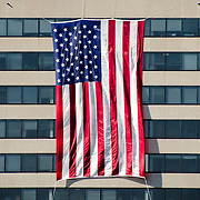 Defense contractors and other business based in Rosslyn, Virginia, drape large flags on the outside of their buildings for the anniversary of the 9/11 terrorist attacks. The Pentagon, which was the target of one of the attacks, is nearby.