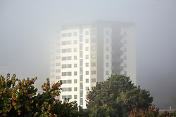 © Licensed to London News Pictures. 20/09/2015. Leeds, UK. Picture shows an apartment building in the fog this morning. The city of Leeds woke this morning to a thick blanket of fog which is expected to clear to a mostly dry clear day..Photo credit: Andrew McCaren/LNP