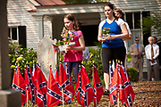 Children place flowers on Confederate tombs at the Confederate Cemetery to mark Confederate Memorial Day on May 10, 2011 in Mount Pleasant, South Carolina.  South Carolina is one of three states that marks the day as a public holiday.