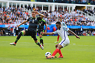 Chris Gunter of Wales (2) attempts to block a cross from Raheem Sterling of England. UEFA Euro 2016, group B , England v Wales at Stade Bollaert -Delelis  in Lens, France on Thursday 16th June 2016, pic by  Andrew Orchard, Andrew Orchard sports photography.