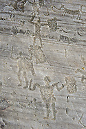 Petroglyph, rock carving, of a warriors with a shields and swords. Carved by the ancient Camunni people in the iron age between  900-1200 BC. Rock no 24, Foppi di Nadro, Riserva Naturale Incisioni Rupestri di Ceto, Cimbergo e Paspardo, Capo di Ponti, Valcamonica (Val Camonica), Lombardy plain, Italy .<br /> <br /> Visit our PREHISTORY PHOTO COLLECTIONS for more   photos  to download or buy as prints https://funkystock.photoshelter.com/gallery-collection/Prehistoric-Neolithic-Sites-Art-Artefacts-Pictures-Photos/C0000tfxw63zrUT4<br /> If you prefer to buy from our ALAMY PHOTO LIBRARY  Collection visit : https://www.alamy.com/portfolio/paul-williams-funkystock/valcamonica-rock-art.html