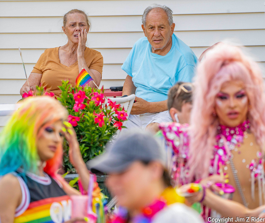 Annette Venezia (left), 80, and Gino Giannini, 82, of Collingswood, New Jersey, watch in amazement as drag queens prepare for the Haddon Township Pride Parade in downtown Collingswood.