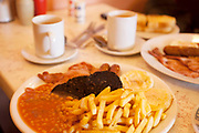 Very large breakfast in a 'greasy spoon; caf. Almost a traditional full English breakfast.
