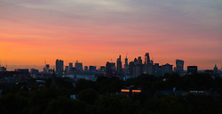 London, August 16 2017 . London wakes up to a glorious sunrise, the city skyline seen from Primrose Hill. © Paul Davey.