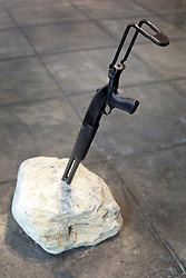 02 October 2014. Jonathan Ferrara Gallery, New Orleans, Louisiana. <br /> Jonathan Ferrara Gallery. 'Guns In The Hands Of Artists' A piece by the gallery owner and artist Paul Jonathan Ferrara. The show brings together over 30 internationally acclaimed artists who took parts from 190 destroyed weapons acquired by the New Orleans Police department  and converted them into art.  <br /> Photo; Charlie Varley/varleypix.com