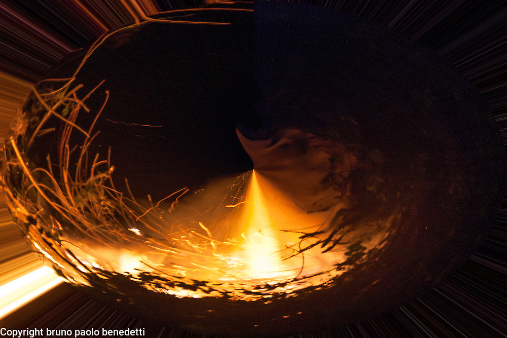 surreal rising fire flame causes with its strenght a fire whirpool