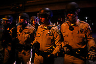California Highway Patrol officers line up in formation after clearing protestors occupying the I-880 freeway following the separate fatal officer-involved shootings of Alton Sterling and Philando Castile, in Oakland, Calif., Thursday, July 7, 2016.<br /> <br /> Sterling was shot by two white Baton Rouge Police Department officers in Baton Rouge, Louisiana and Castile was shot by a St. Anthony police officer in Falcon Heights, Minnesota.