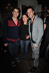 Left to right, ADAM GARCIA, DIANA VERVENIETO and JASON GARDINER at a party to celebrate the publication of her new book - Kelly Hoppen: Ideas, held at Beach Blanket Babylon, 45 Ledbury Road, London W11 on 4th April 2011.