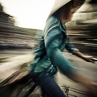 Woman biking home from market, Hanoi, Vietnam