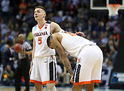 ANDREW SHURTLEFF/THE DAILY PROGRESS<br /> Virginia guard Kyle Guy (5) consoles teammate Isaiah Wilkins (21) after loosing to UMBC 74-54 in the first round of the NCAA Tournament Friday in Charlotte.