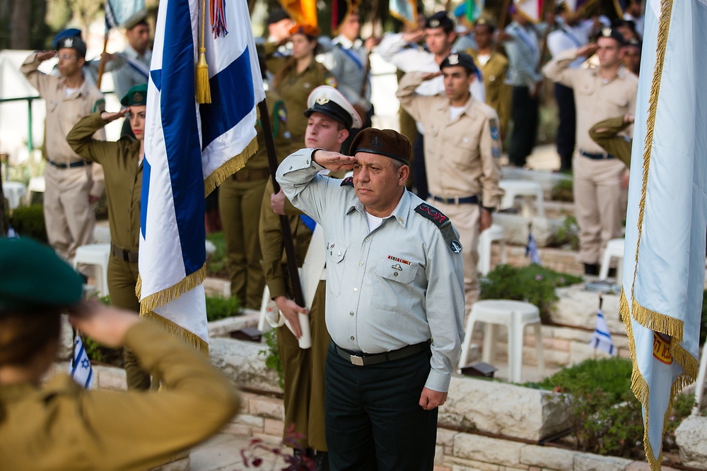 Israeli Chief of Staff, Major General Gadi Eisenkot salutes in honor of fallen soldiers, during a memorial ceremony at the Mount Herzl military cemetery in Jerusalem, Israel, on April 19, 2015, ahead of the annual Memorial Day honoring fallen soldiers and Victims of Terrorism, which begins Tuesday night.
