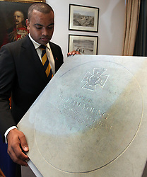 © Licenced to London News Pictures. 04/11/2013. London. UK.  <br /> Lance Sergeant Johnson Beharry, the first living recipient of the Victoria Cross in over 30 years, unveils the design of the paving stone which will commemorate recipients of the Victoria Cross during the First World War at the Army and Navy Club in London, November 4th 2013. The winning design, following a national competition, will be set in stone in over 400 communities across the United Kingdom to commemorate those First World War soldiers who were awarded the Victoria Cross for valour 'in the face of the enemy'.<br /> Photo Credit: Susannah Ireland